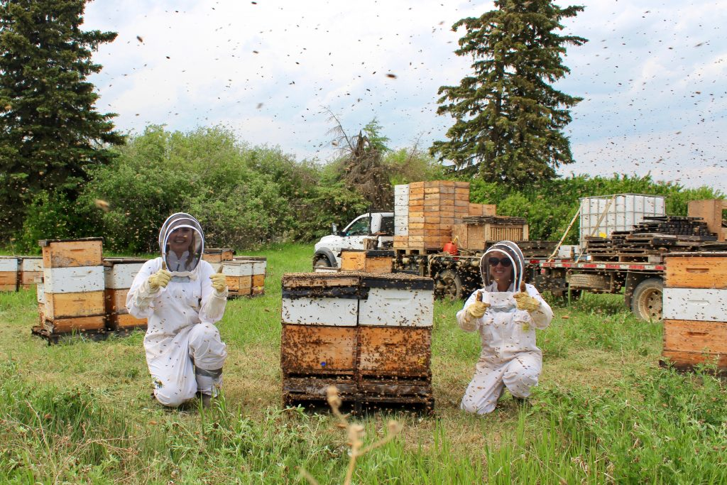 Two women in the honey bees